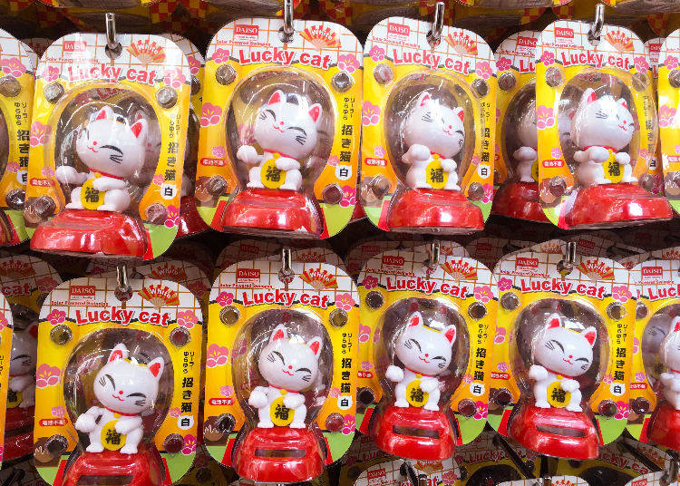 6. The Solar-Powered White Lucky Cat -- Be Soothed By 6. Its Charming Gesture! Summon Good Luck With This Solar-Powered White Lucky Cat