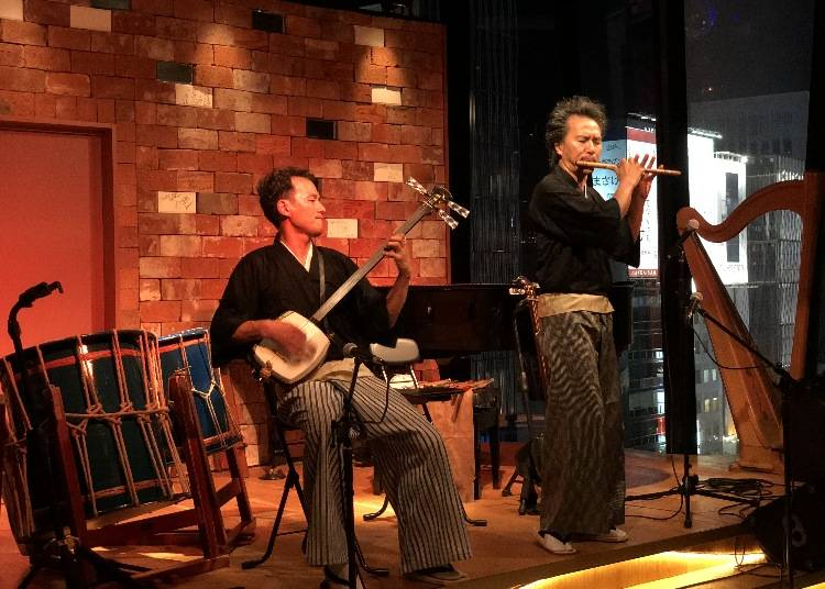 Enjoying a traditional Japanese music concert during your stay in Tokyo