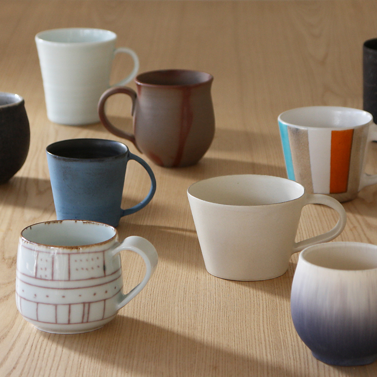Mugs by fourteen Japanese potteries
