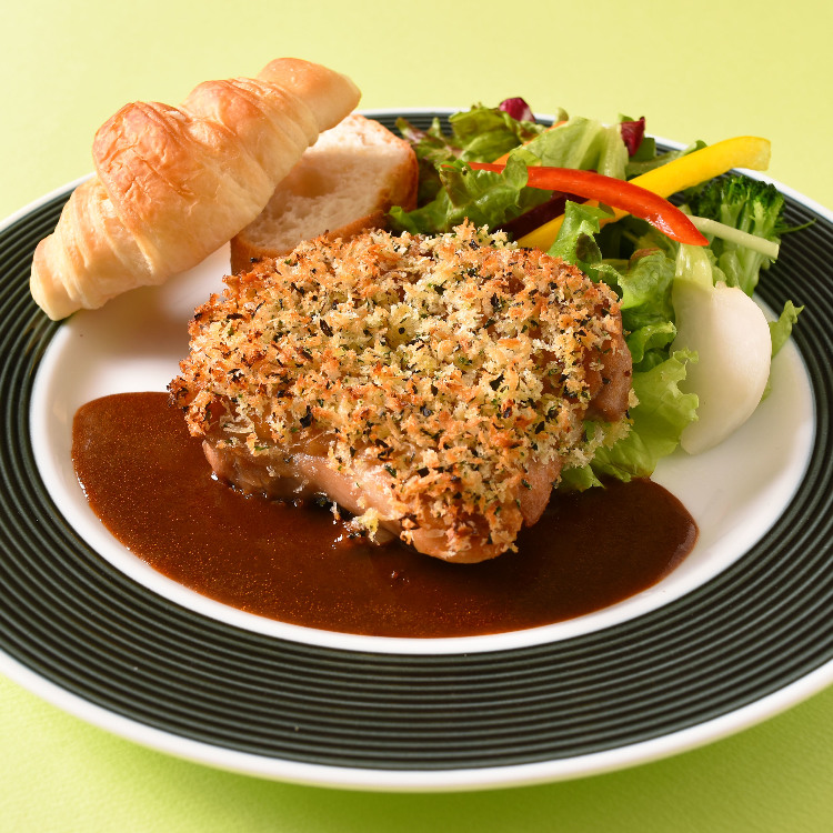 herb-crusted grilled chicken with demi-glace sauce