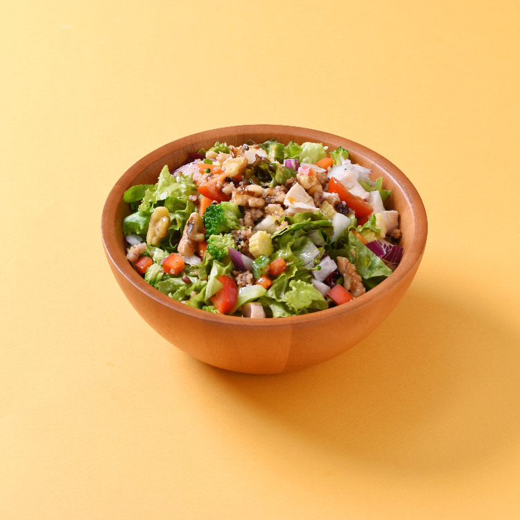 chopped salad of colorful vegetables with steamed chicken