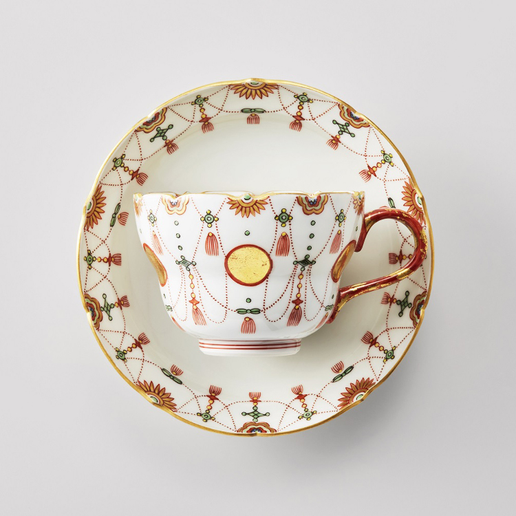 Cup & saucer set in red and gold-painted porcelain